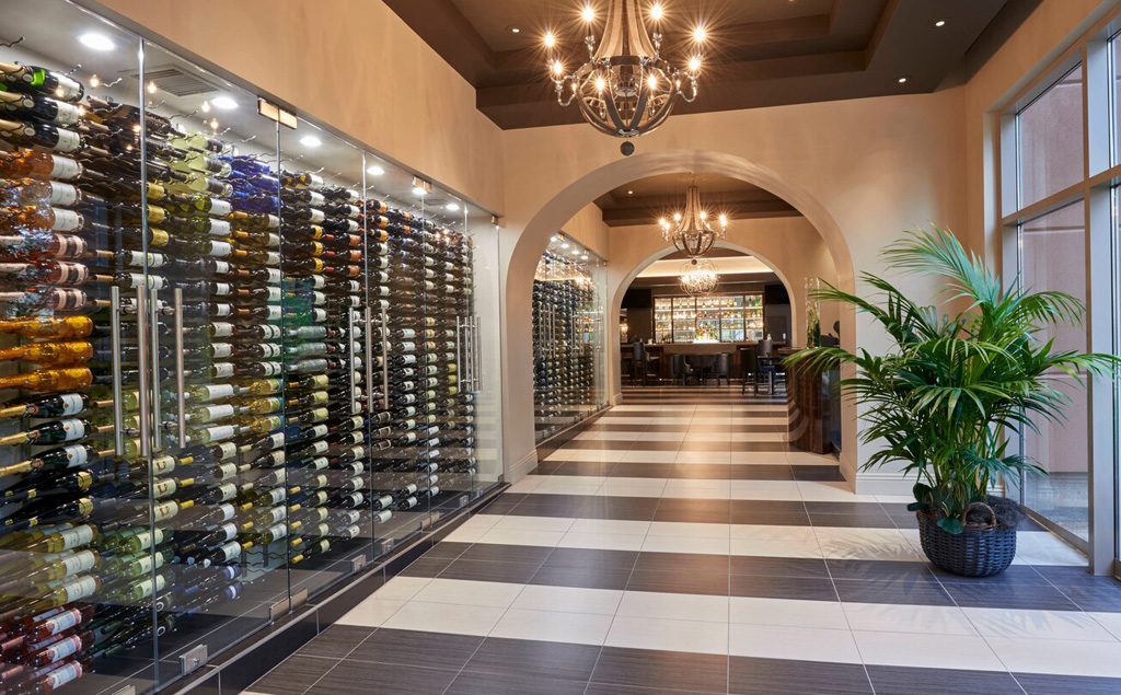 JW Marriott Las Vegas hallway line with wine racks behind glass doors